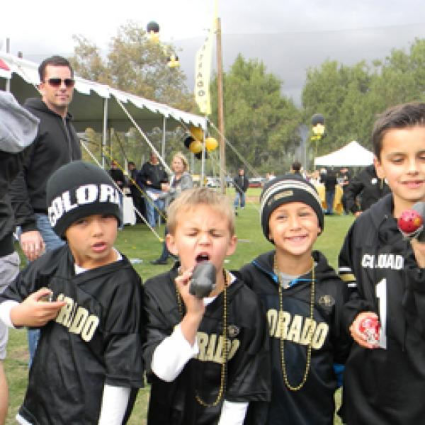 cu boulder family in buffs gear for the game