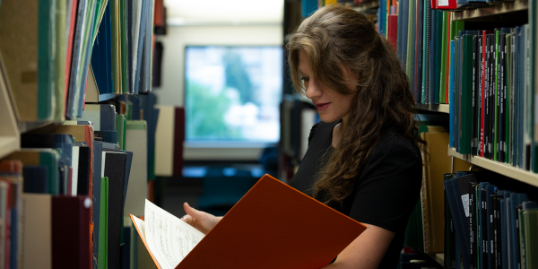 an alum researching in the library