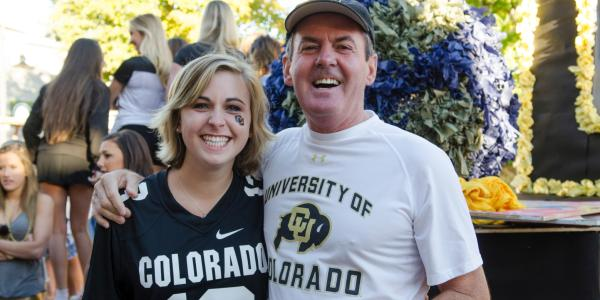 parent and student wearing cu boulder gear