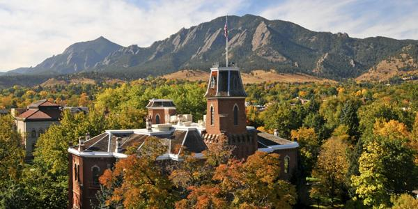 iconic cu building Old Main in front of the Flatiron mountain range