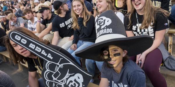 cu boulder students cheer in the stands at an athletic event