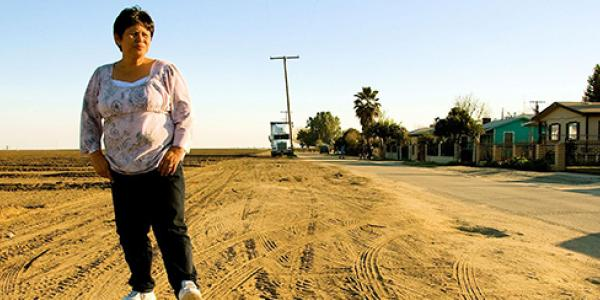 Teresa DeAnda near her home in Earlimart, Calif., where a pesticide drift incident sickened more than 250 people.