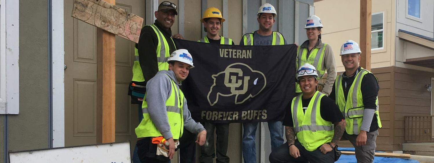 CU Veterans group and flag photo