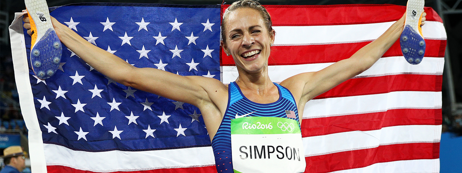 Jenny Simpson holding an American flag