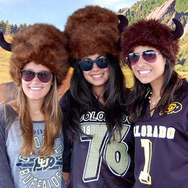 Three Forever Buffs in spirited outfits