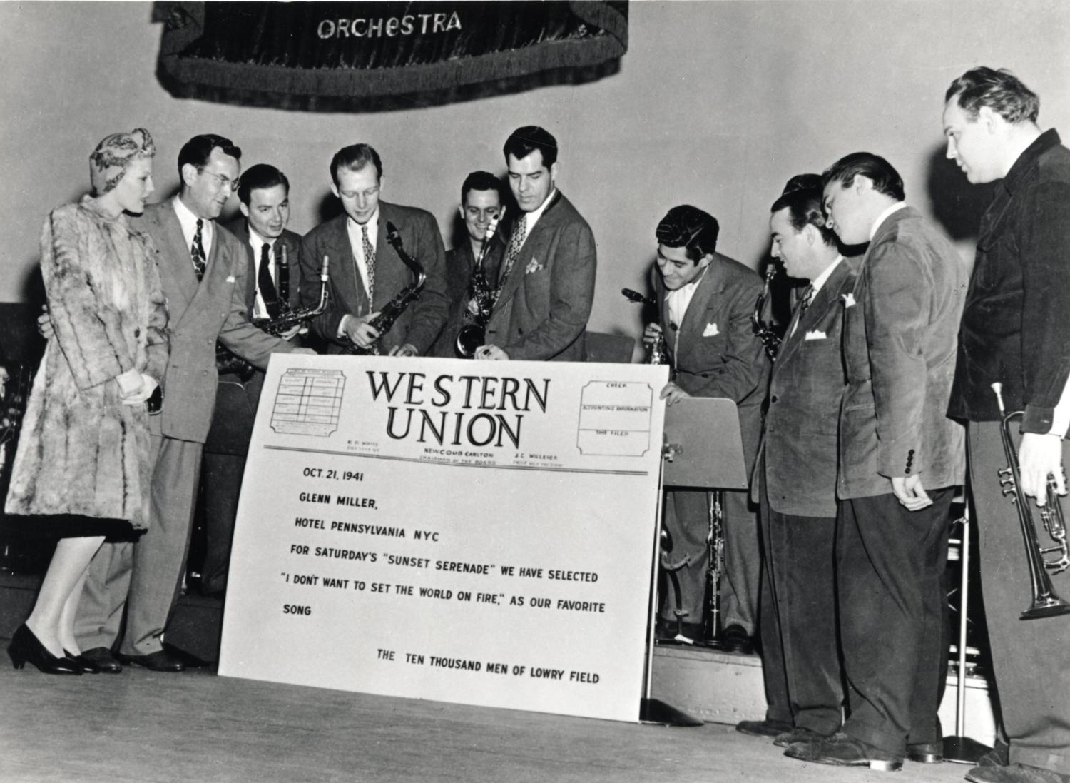 Group photo with large display of Lowry Telegram