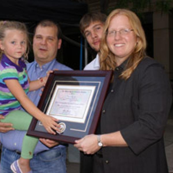 Kristi receiving her Distinguished Researcher Award