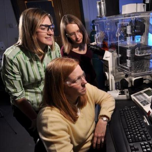 Kristi showing students microscopy techniques