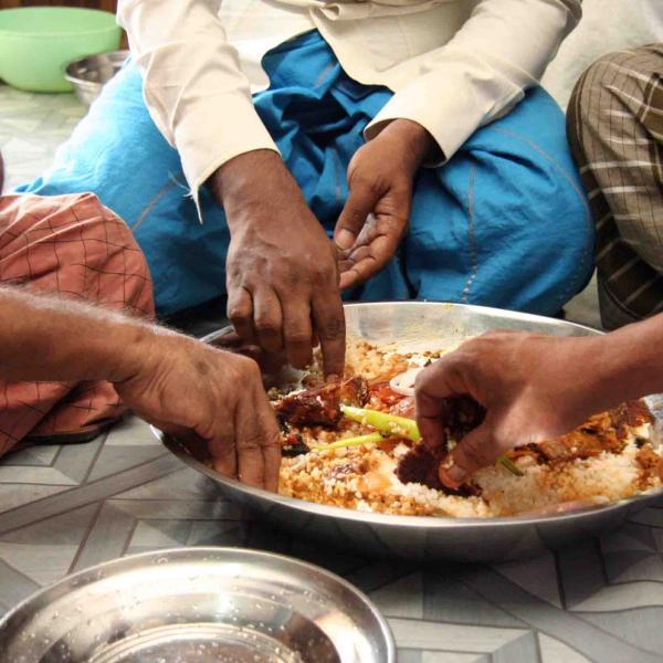 group around communal food bowl