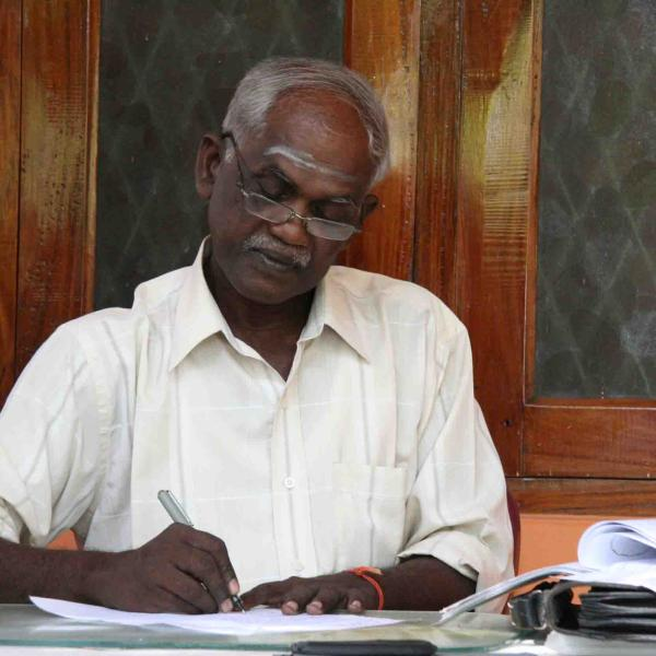 Akkaraipattu man writing on paper