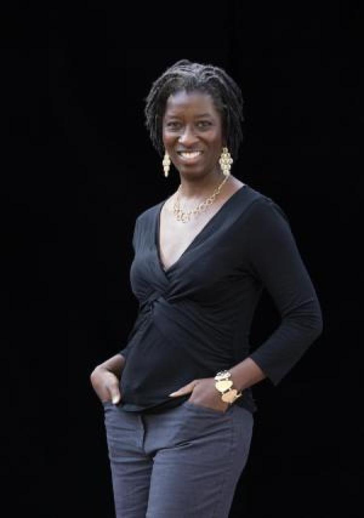 Kaifa Roland standing with black background