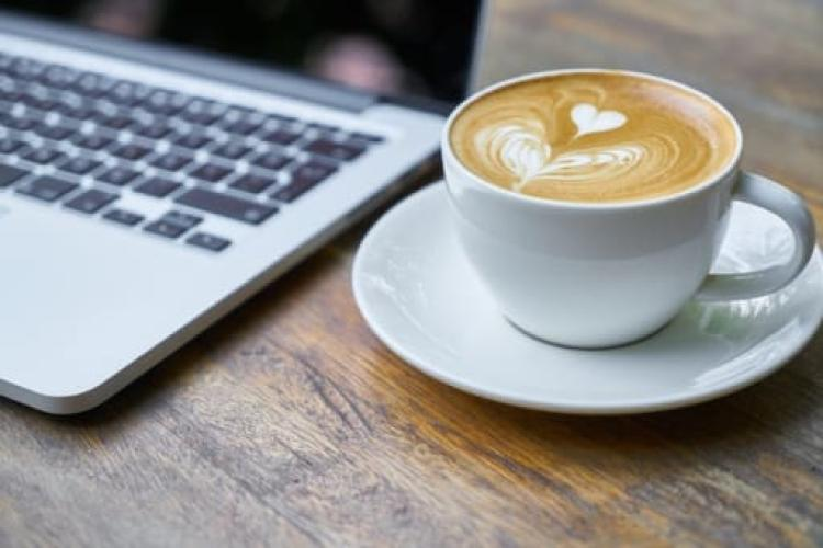 Coffee cup and computer