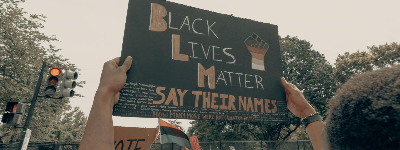 protestor holding a black lives matter sign