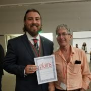 Carlton and Prof Bamforth holding a plains certificate