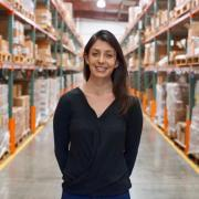 Cydney Justman standing in a warehouse