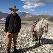 Will in the mountains with a horse