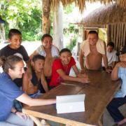Sarah Kurnick meeting with locals in the field