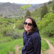 Sarah Kurnick hiking in the field