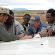 Terry going over documents in the field in Africa