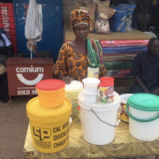 Milk vendor at local outdoor market in The Gambia during the rainy season in 2016.