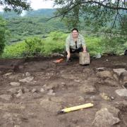 Team member working on the dig