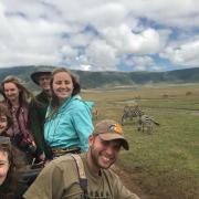 Students in A Field Near Zebras in Tanzania 2018
