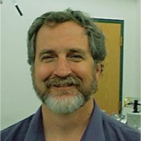 Headshot of Prof. Web Cash