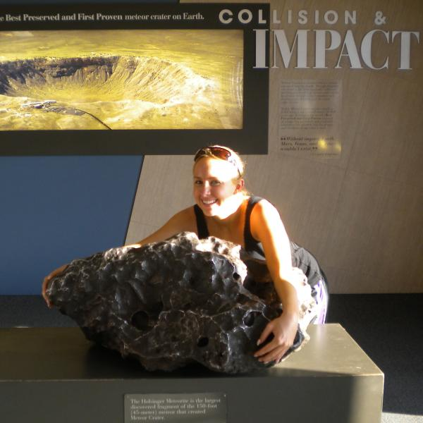 Jessica Roberts holding meteor at Meteor Crater