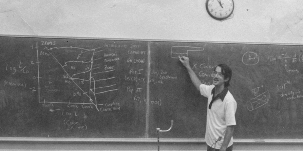 Doug Duncan at a blackboard, teaching at the Summer Science Program in the 1970s