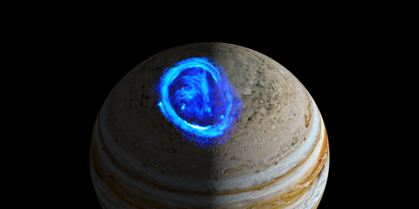 Image of the planet Jupiter showing prominent blue aurora near the north pole