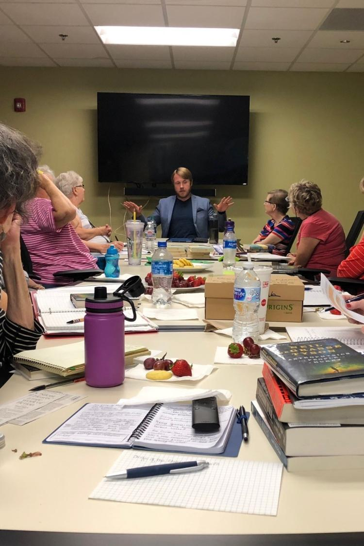 "Brian Alden leads a book club discussion of Neil DeGrasse Tyson's ""Astrophysics for People in a Hurry"""