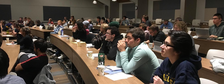 Astrophysics students listen intently