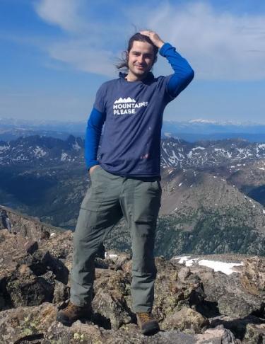 Alex Haughton atop a mountain