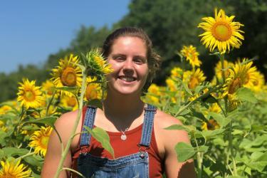 Megan Kenny among sunflowers