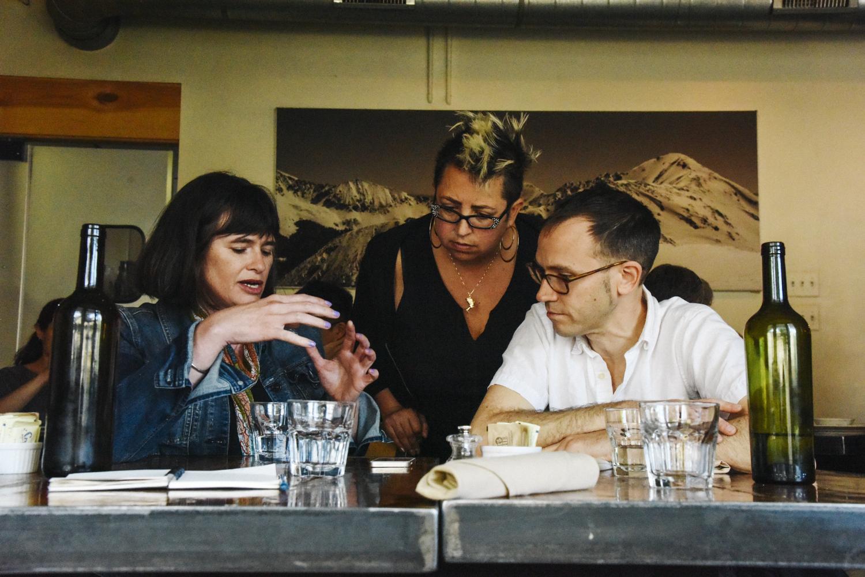 Phoebe Young, Jeremiah Lockwood, and Jewlia Eisenberg at work