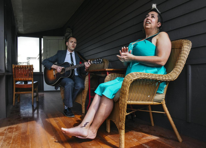 Jeremiah Lockwood and Jewlia Eisenberg performing music on porch at Chautauqua