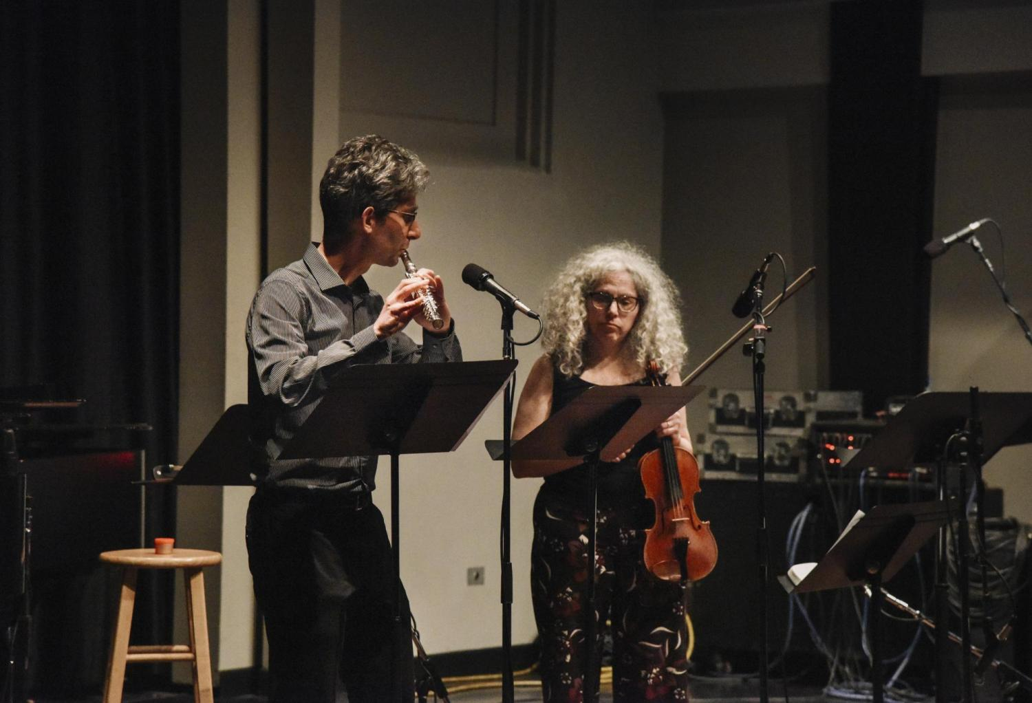Alicia Svigals and Yonatan Malin performing on stage