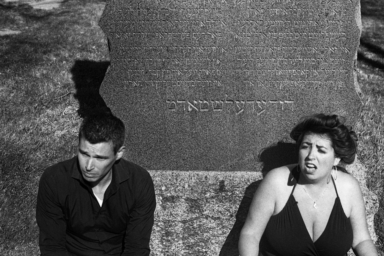 David Shneer and Jewlia Eisenberg sitting at the cemetery