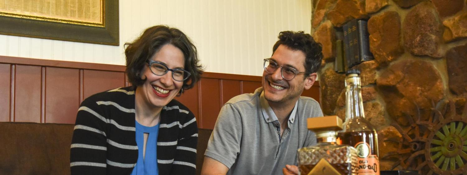 Janice Fernheimer and JT Waldman sitting besides each other and smiling