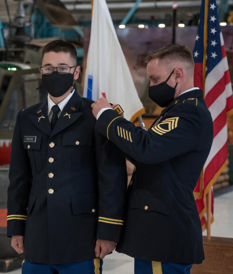 MSG Evan Reed [right] is pinning on Cadet William Ascik's Second Lieutenant shoulder bars. Photo courtesy of Cadet Arianna Decker.