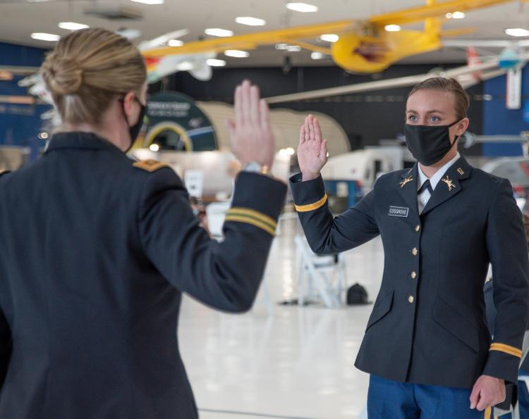 Major Jennifer Staton [left] does the honor of swearing in the Oath of Office to Cadet Emily Cosgrove. Photo courtesy of Cadet Arianna Decker.