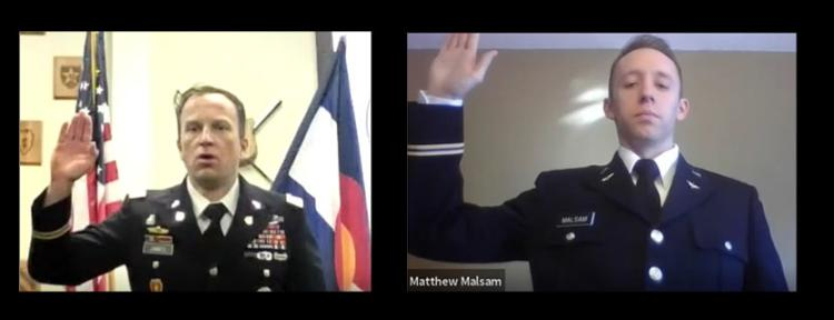 MAJ Joshua James is swearing in Cadet Matthew Malsam to become a Second Lieutenant in the U.S. Army.