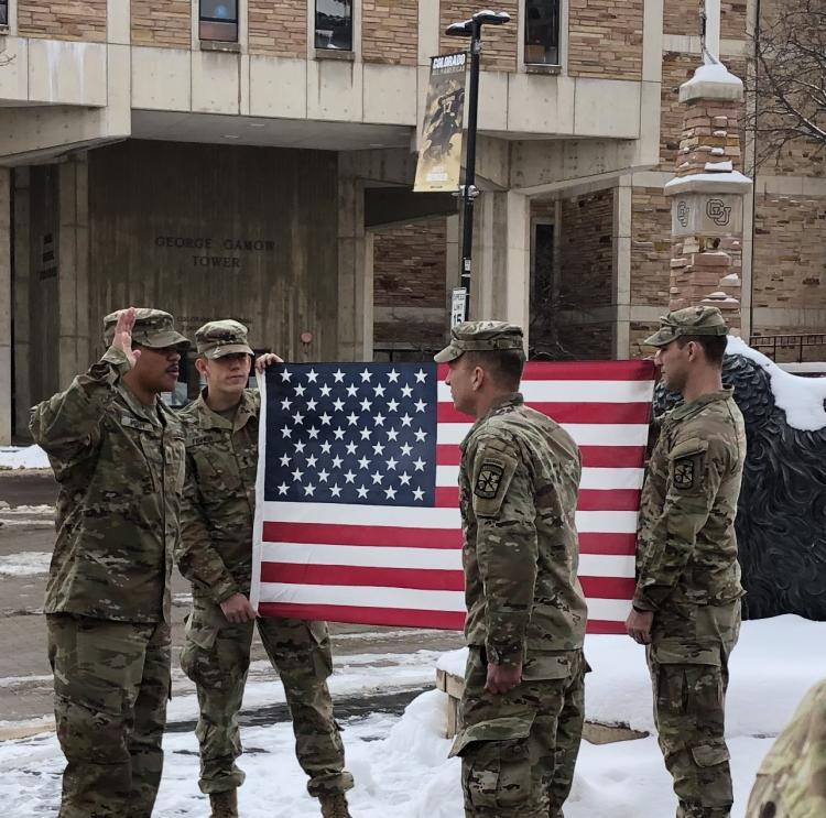CDT Jack Fisher (L) and CDT Tyson Pyles (R), Two CU AROTC Cadets hold the U.S. Flag while MAJ Joshua James swears in SGT Russell Penn (hand raised on left).