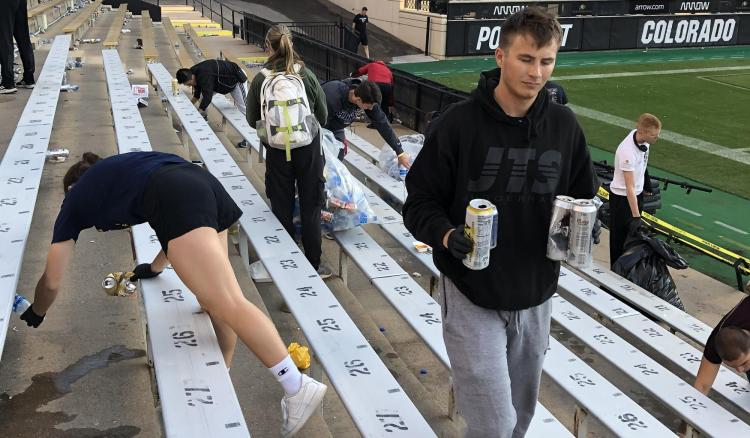 Army ROTC Cadets picking up the recycling and waste left in the stands after the second home football game of the 2021 season.