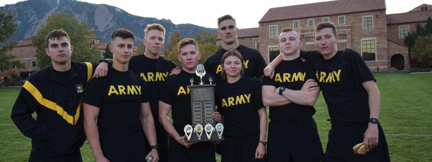 Golden Buffalo Battalion holding their trophy,