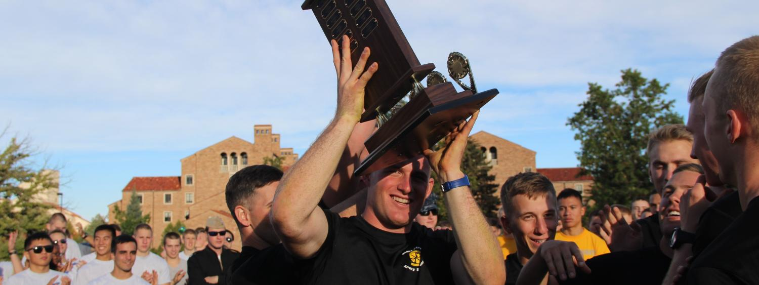 Army ROTC carrying trophy after winning the Tri-Mil Competition.