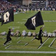 AROTC members doing pushups during the game for every point scored by CU.