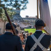 Army ROTC Color Guard Cadets march into Folsom Stadium to display the colors at the September 18th CU football game against Minnesota. Photo courtesy of Cadet Arianna Decker.