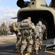 Cadets boarding a Chinook helicopter courtesy of the Colorado Army National Guard.