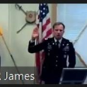 """LTC Mark Van Gelder (left) and MAJ Joshua James (right) issuing the """"Oath of Office"""" to the Second Lieutenant's during the Commissioning Ceremony in the Army ROTC Cadet Lounge."""